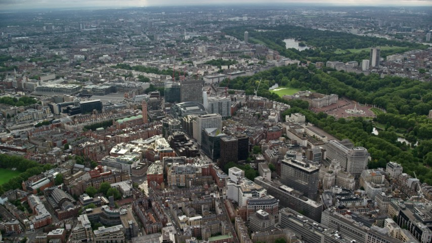 6K stock footage aerial video pan across office buildings near Buckingham Palace, London, England Aerial Stock Footage | AX115_216