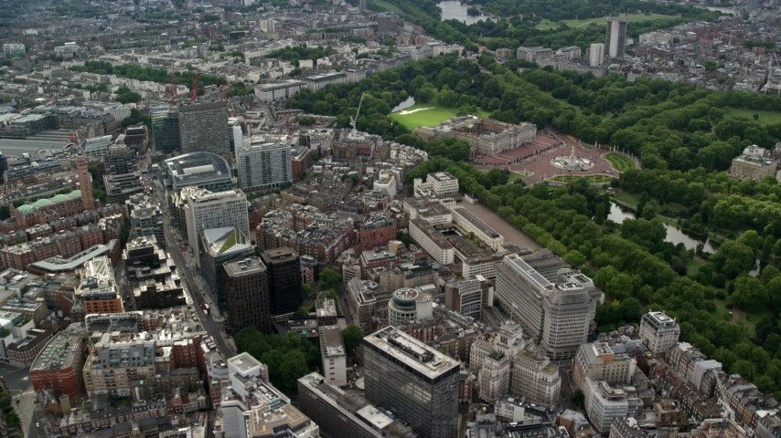 6K stock footage aerial video flyby office buildings toward Buckingham Palace, London, England Aerial Stock Footage | AX115_217