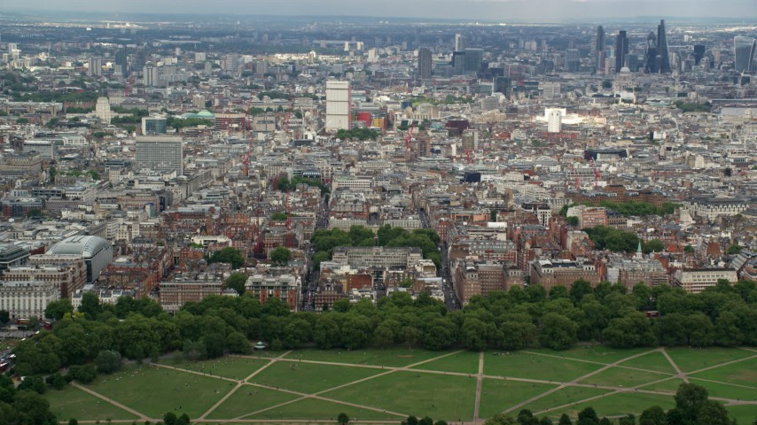 6K stock footage aerial video of a view of the London cityscape from Hyde Park, England Aerial Stock Footage | AX115_227