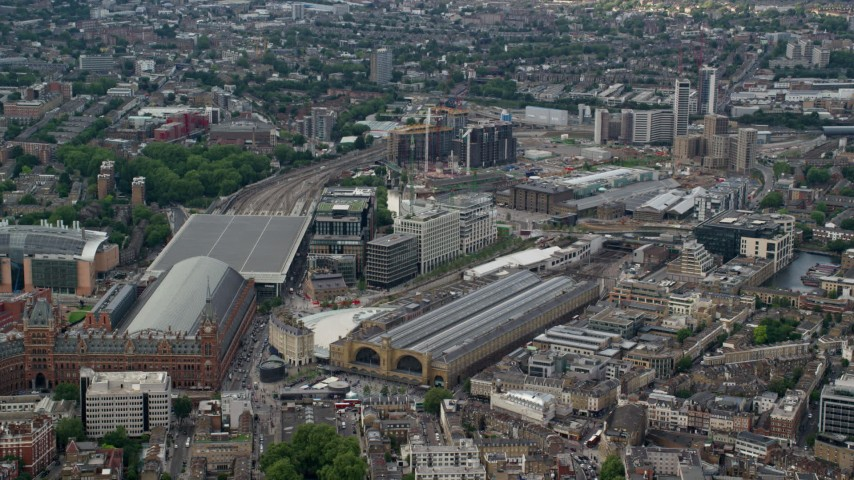 6K stock footage aerial video of Kings Cross Station and office buildings, London, England Aerial Stock Footage | AX115_236