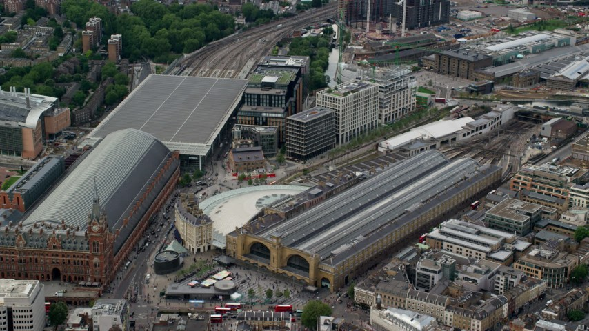 6K stock footage aerial video approach the Kings Cross Train Station, London, England Aerial Stock Footage AX115_237 | Axiom Images