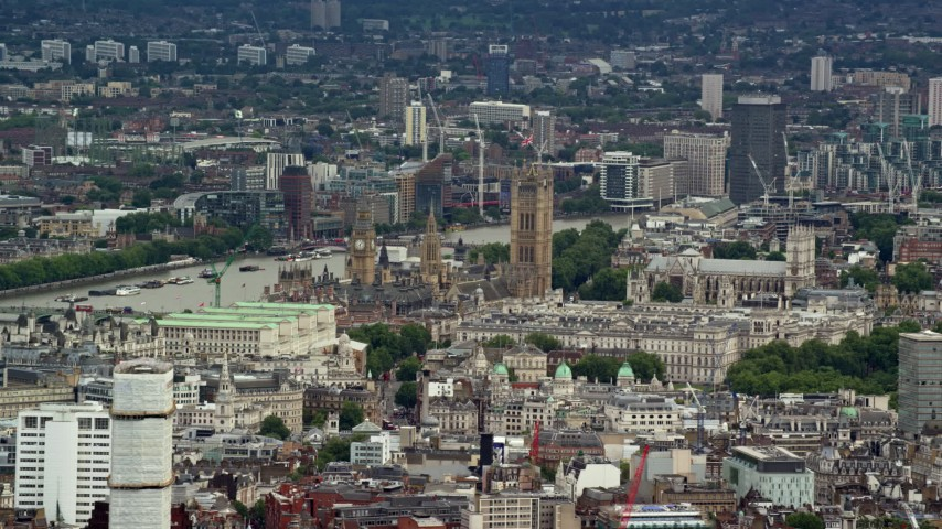 Big Ben and Parliament among city buildings, London England Aerial Stock Footage | AX115_240