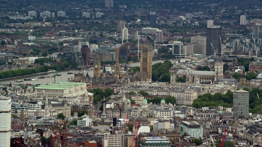 6K stock footage aerial video of a view of Big Ben and Parliament among city buildings, London, England Aerial Stock Footage | AX115_240
