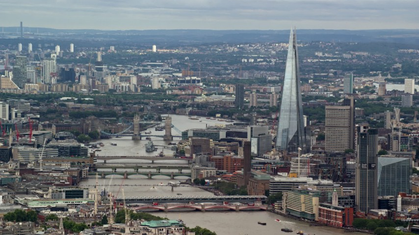 6K stock footage aerial video of The Shard, and Tower Bridge spanning the Thames among cityscape, London, England Aerial Stock Footage | AX115_246