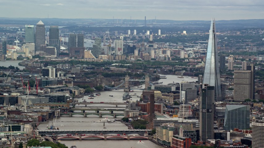 6K aerial video of The Shard, Tower Bridge and Canary Wharf in London, England Aerial Stock Footage | AX115_248