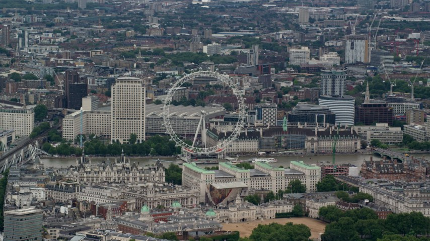 6K aerial video of the London Eye and nearby city buildings, England Aerial Stock Footage | AX115_249
