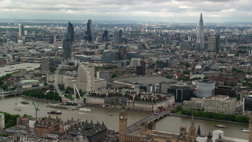 6K stock footage aerial video of skyscrapers in Central London, London Eye and Parliament, England Aerial Stock Footage | AX115_255