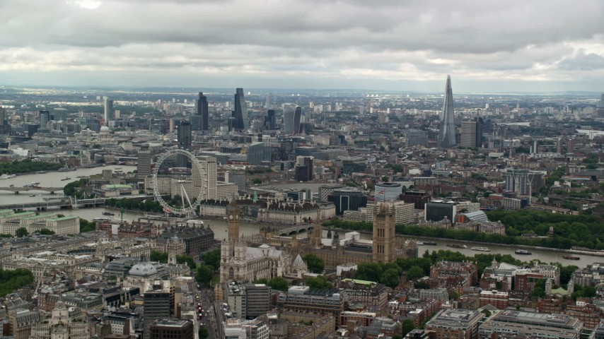 6K stock footage aerial video of the cityscape, the London Eye, and Parliament, England Aerial Stock Footage | AX115_256