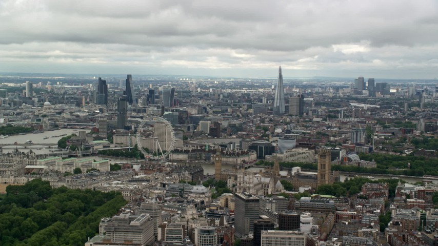 6K stock footage aerial video of a wide view of the London cityscape from Parliament and London Eye, England Aerial Stock Footage | AX115_257