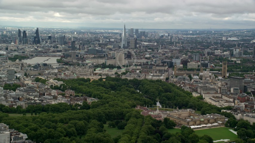 6K stock footage aerial video of the London cityscape seen from Buckingham Palace, England Aerial Stock Footage | AX115_259