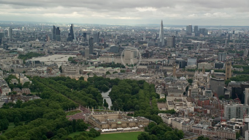 6K stock footage aerial video of the city of London seen while passing Buckingham Palace, England Aerial Stock Footage | AX115_265