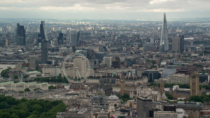 6K stock footage aerial video of the London Eye with skyscrapers in the background, England Aerial Stock Footage | AX115_266