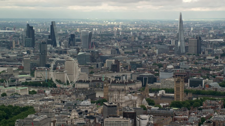 6K stock footage aerial video the London Eye and Parliament, with skyscrapers in the background, England Aerial Stock Footage | AX115_267