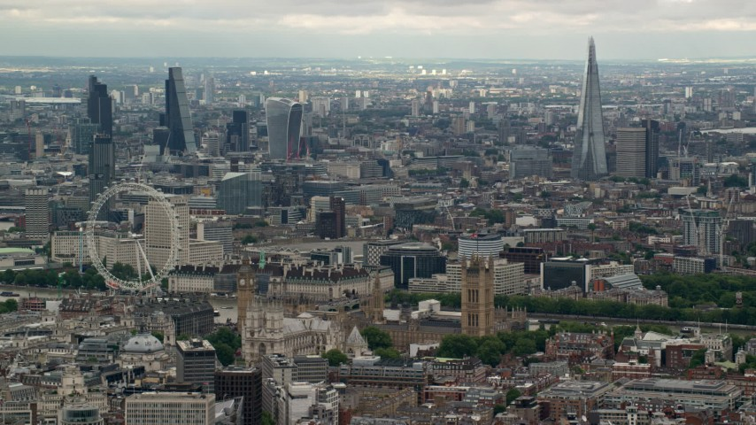 Cityscape including Big Ben, Parliament, London Eye, England Aerial Stock Footage | AX115_268