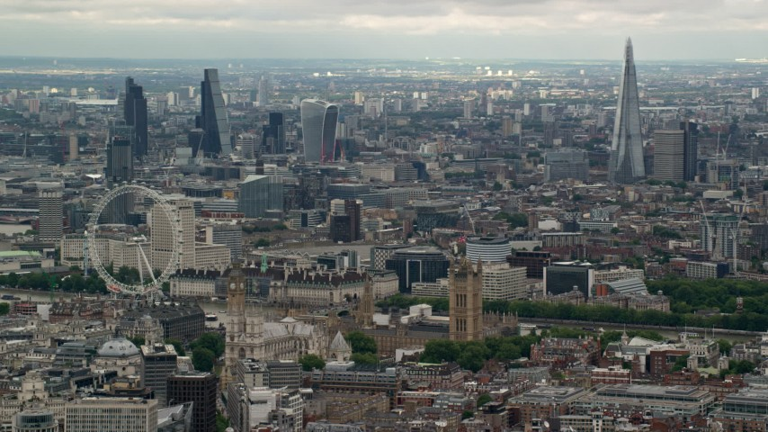 6K stock footage aerial video of the London cityscape, including Big Ben, Parliament, London Eye, England Aerial Stock Footage | AX115_268