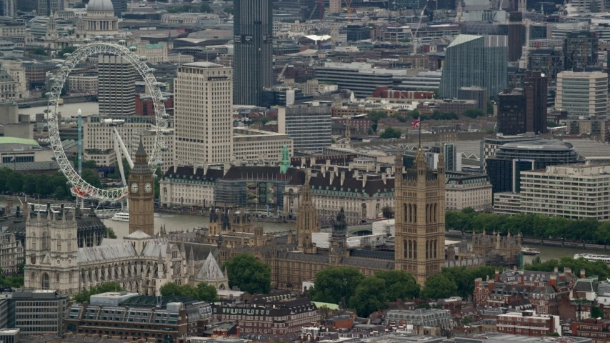 Flying by Big Ben, Parliament and London Eye, England Aerial Stock Footage | AX115_270