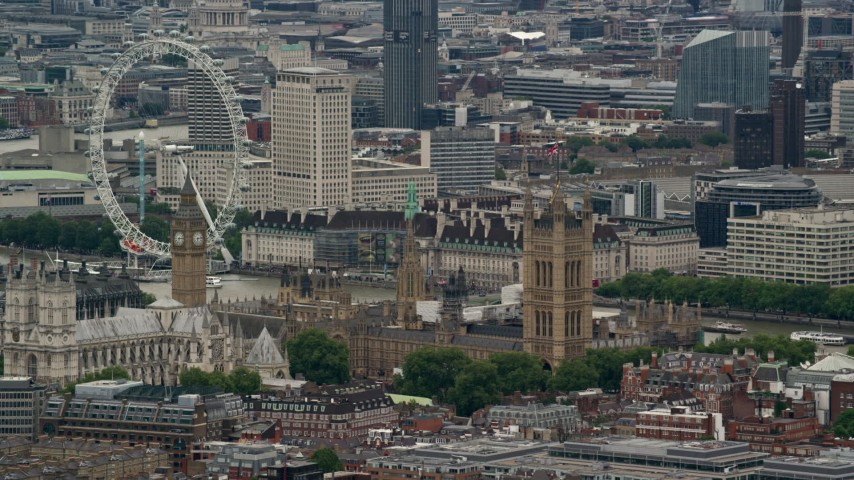 6K stock footage aerial video of flying by Big Ben, Parliament and London Eye, England Aerial Stock Footage | AX115_270