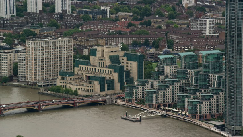 6K stock footage aerial video of MI6 Building beside the River Thames, London, England Aerial Stock Footage | AX115_271