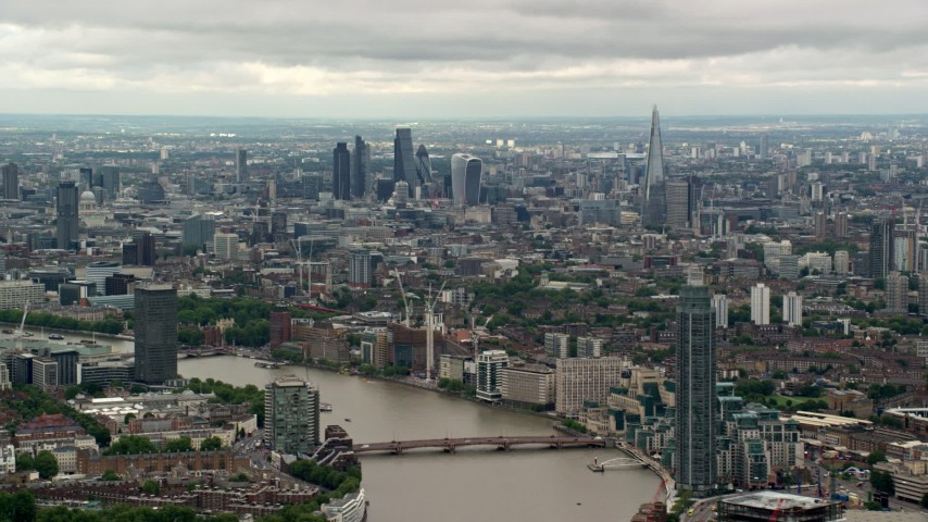 6K aerial video of Central London skyscrapers seen from near MI6 Building, England Aerial Stock Footage | AX115_272