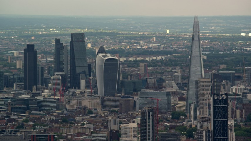 6K stock footage aerial video of Central London skyscrapers, The Shard and Strata in foreground, England Aerial Stock Footage | AX115_275