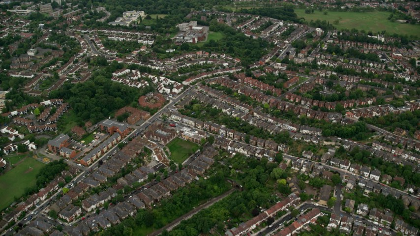 6K stock footage aerial video fly over rows of homes in residential neighborhoods, London, England Aerial Stock Footage | AX115_281