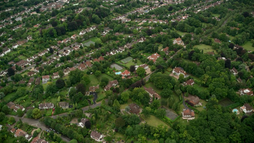 6K stock footage aerial video fly over residential neighborhoods with trees, Purley, England Aerial Stock Footage | AX115_296