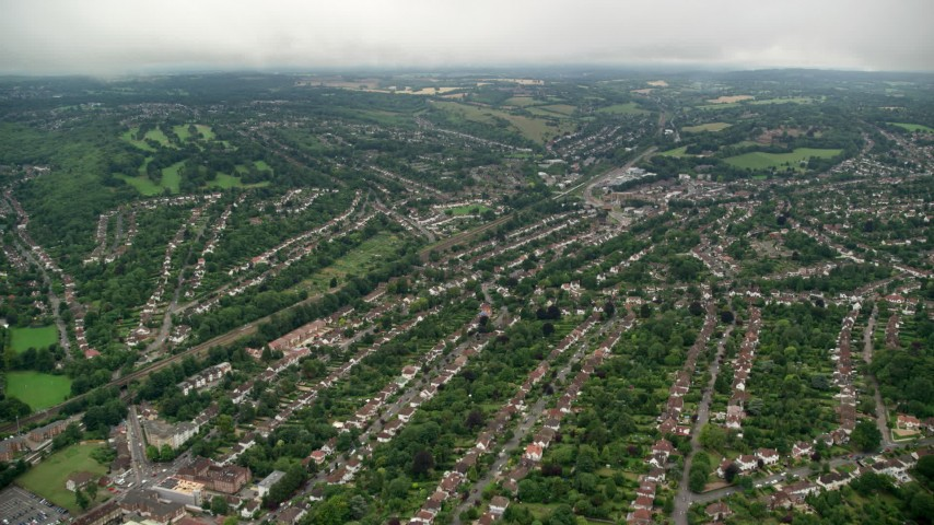 6K stock footage aerial video fly over rows of homes with trees, Purley, England Aerial Stock Footage | AX115_297