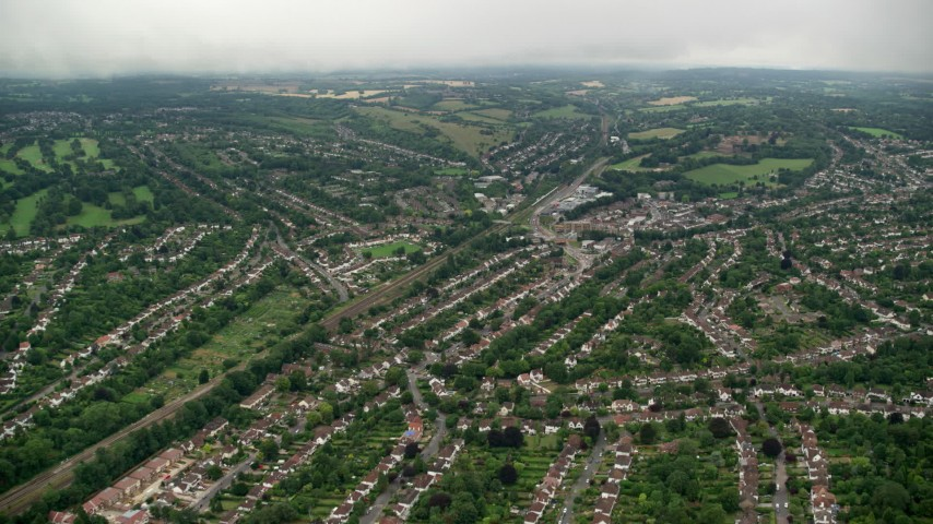6K stock footage aerial video of flying over suburban homes with trees, Purley, England Aerial Stock Footage AX115_298