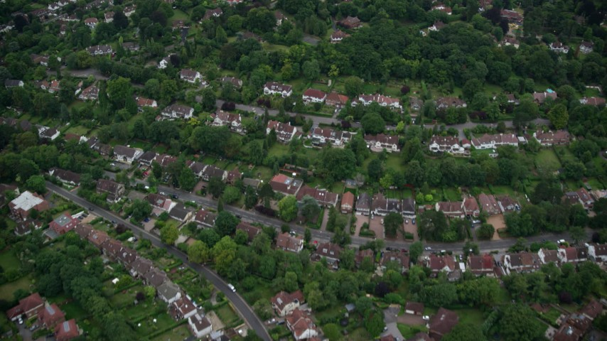 6K stock footage aerial video of flying away from homes in Purley, England, twilight Aerial Stock Footage | AX116_004