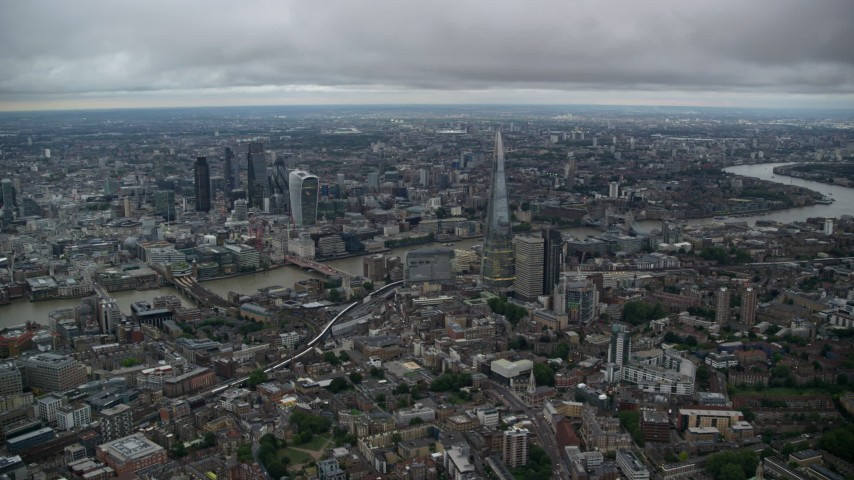 Skyscrapers, River Thames and Central London cityscape, England, twilight Aerial Stock Footage | AX116_009