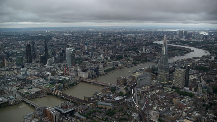 6K stock footage aerial video of skyscrapers and bridges spanning the River Thames, London, England, twilight Aerial Stock Footage | AX116_010