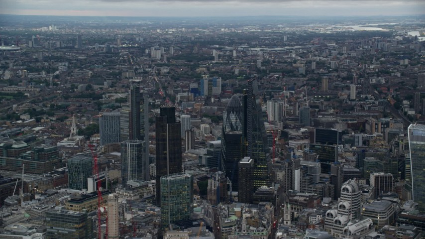 6K stock footage aerial video of Heron Tower, Tower 42, The Gherkin, Leadenhall skyscrapers, London, England, twilight Aerial Stock Footage | AX116_011