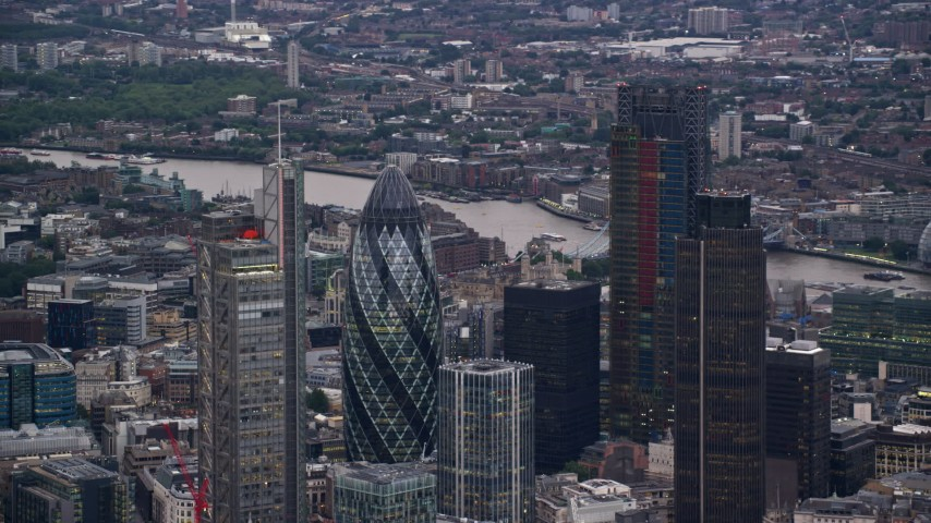 6K stock footage aerial video of an orbit of Central London skyscrapers, London, England, twilight Aerial Stock Footage AX116_014 | Axiom Images