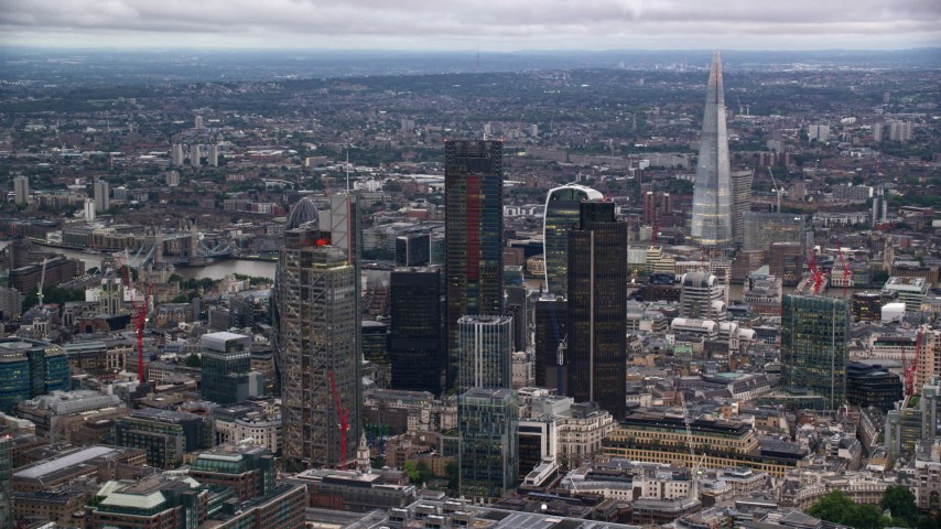 6K stock footage aerial video of skyscrapers, with The Shard in distance, London, England, twilight Aerial Stock Footage | AX116_016