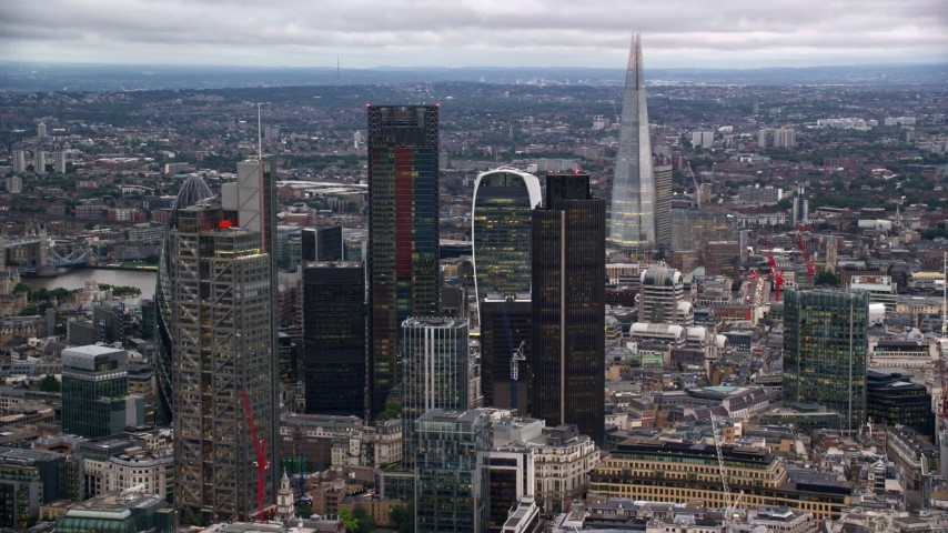 6K stock footage aerial video approach skyscrapers, with The Shard in the distance, London England, twilight Aerial Stock Footage | AX116_017