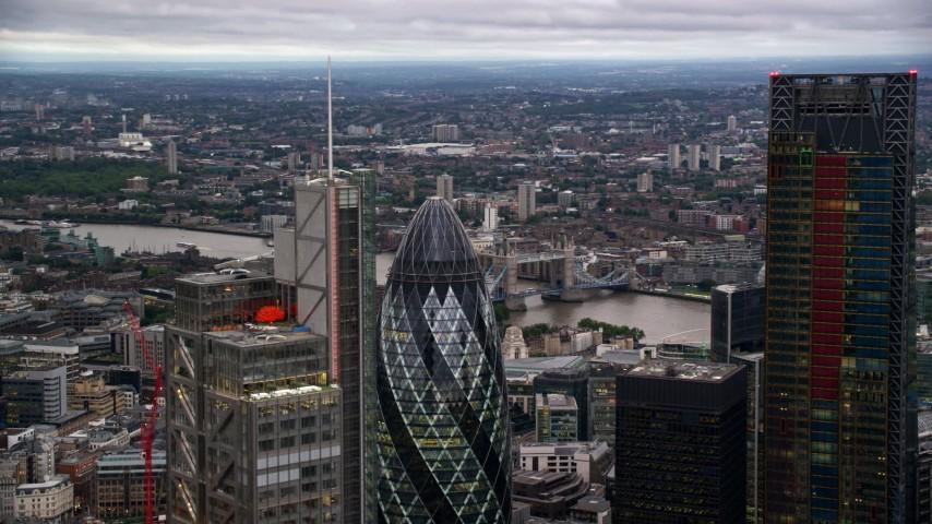 6K stock footage aerial video flyby Heron Tower, reveal The Gherkin skyscraper, London, England, twilight Aerial Stock Footage | AX116_018