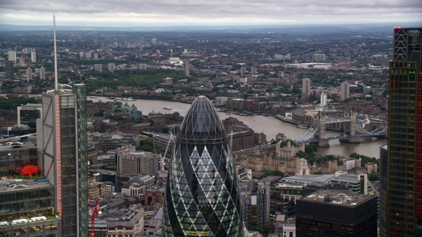 6K stock footage aerial video of orbiting The Gherkin skyscraper, London, England, twilight Aerial Stock Footage | AX116_019