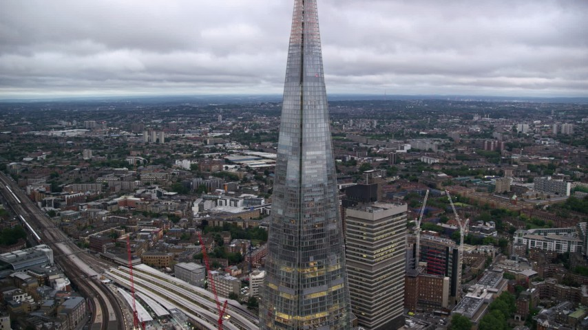 6K stock footage aerial video of flying by The Shard skyscraper in London, England, twilight Aerial Stock Footage | AX116_021