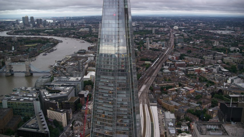 6K stock footage aerial video orbit The Shard, reveal River Thames and Tower Bridge, London, England, twilight Aerial Stock Footage | AX116_022