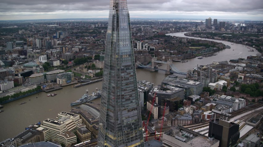 6K stock footage aerial video of flying away from The Shard skyscraper and River Thames in London, England, twilight Aerial Stock Footage | AX116_023