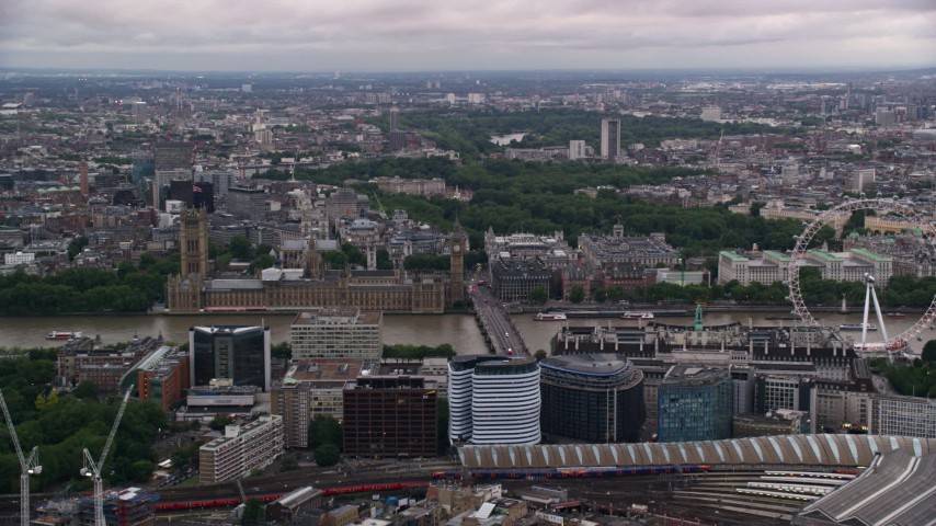 6K stock footage aerial video of approaching British Parliament and Big Ben, London, England, twilight Aerial Stock Footage | AX116_024