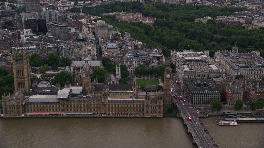 6K stock footage aerial video approach British Parliament, Big Ben, and Westminster Abbey, London, England, twilight Aerial Stock Footage | AX116_026