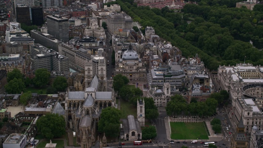6K stock footage aerial video fly over Westminster Abbey toward Westminster Central Hall, London, England, twilight Aerial Stock Footage | AX116_027