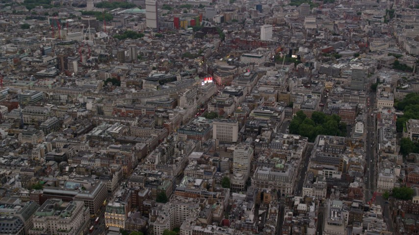 6K stock footage aerial video of flying by Piccadilly Circus, London, England, twilight Aerial Stock Footage | AX116_031