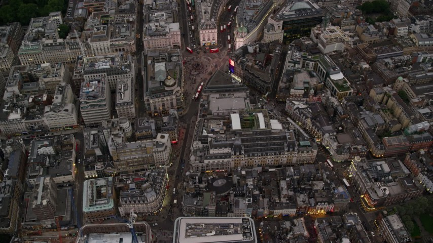 6K stock footage aerial video of a bird's eye view of Piccadilly Circus, London, England, twilight Aerial Stock Footage AX116_037 | Axiom Images