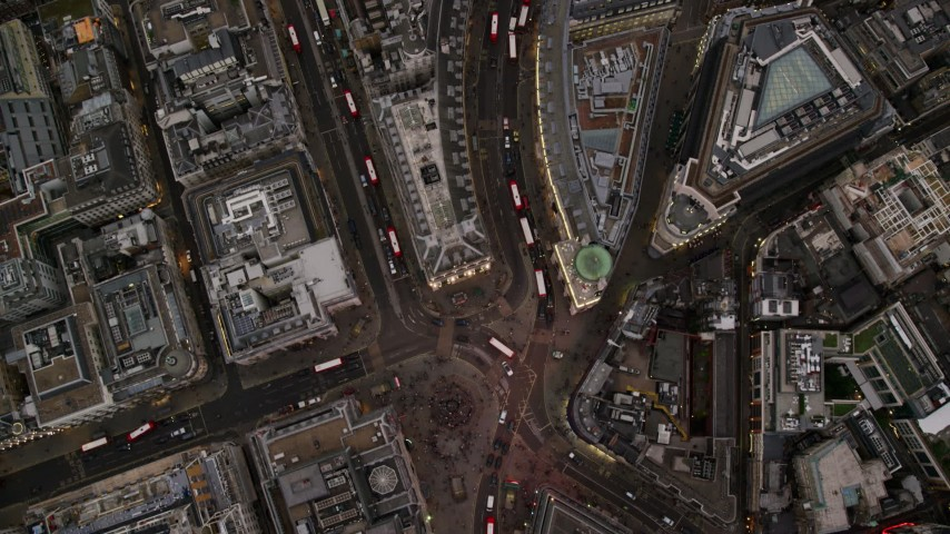 6K stock footage aerial video of a bird's eye view of Piccadilly Circus and Regent Street, London, England, twilight Aerial Stock Footage | AX116_039