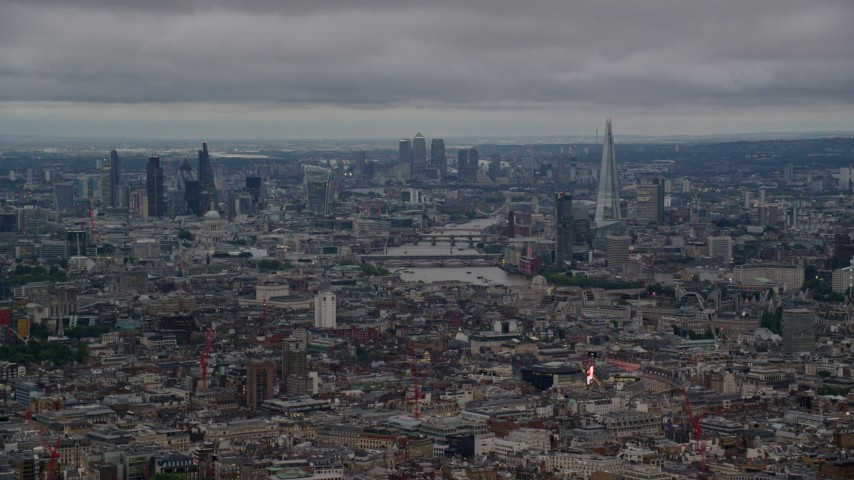 6K stock footage aerial video of a view of the River Thames and Central London skyscrapers, England, twilight Aerial Stock Footage | AX116_049