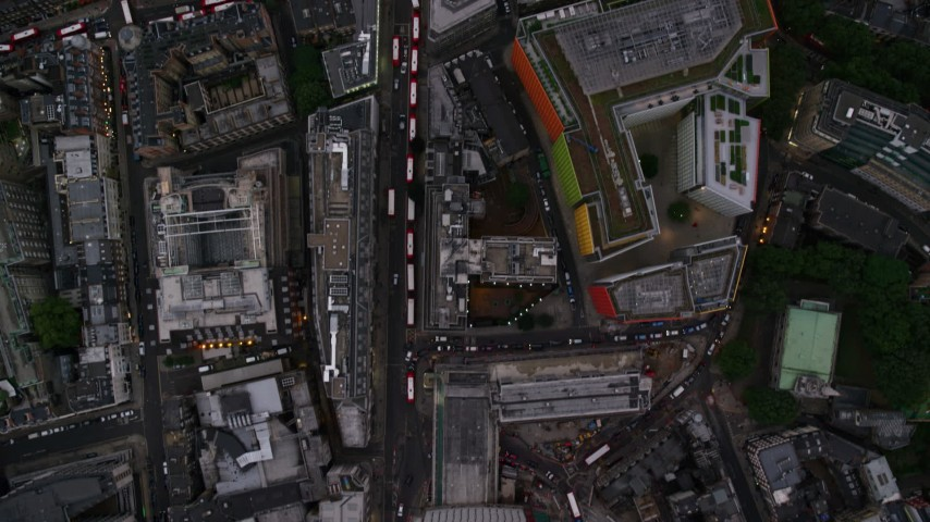 6K stock footage aerial video of a bird's eye view over Oxford Street, reveal Central St Giles, London, England, twilight Aerial Stock Footage | AX116_056