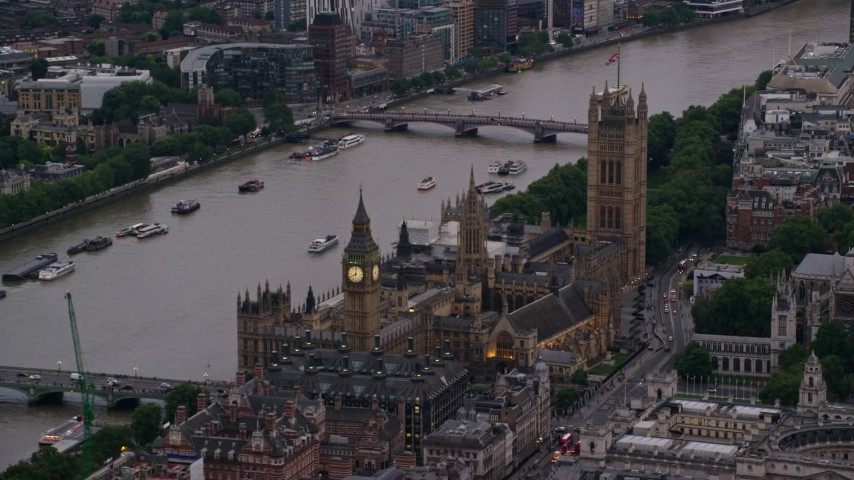 6K stock footage aerial video of flying by Big Ben and British Parliament on River Thames, London, England, twilight Aerial Stock Footage | AX116_059