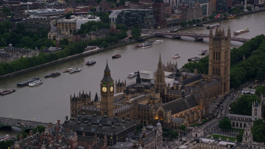 6K stock footage aerial video of Big Ben and British Parliament on River Thames, London, England, twilight Aerial Stock Footage | AX116_060